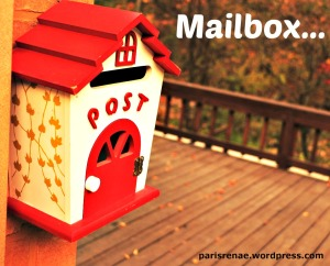 cute red mail box with flowersx